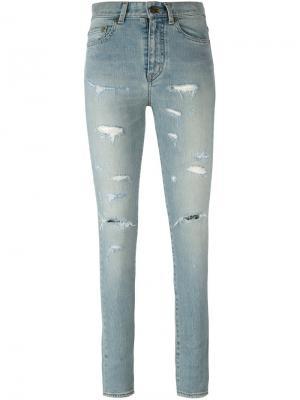Рваные узкие джинсы Saint Laurent. Цвет: синий